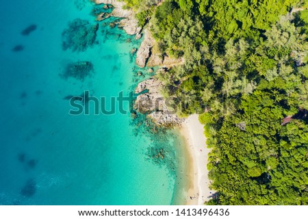 View from above, stunning aerial view of a tropical coast with a white beach bathed by a turquoise clear sea. Phuket, Thailand. Stok fotoğraf ©