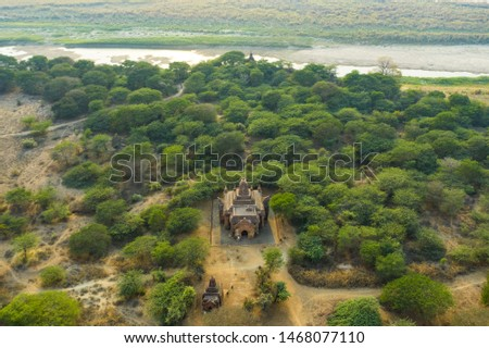 View from above, stunning aerial view of the beautiful Bagan Archaeological Zone (formerly Pagan) during sunset. Drone picture over hundreds of temples surrounded green rich vegetation, Myanmar. #1468077110