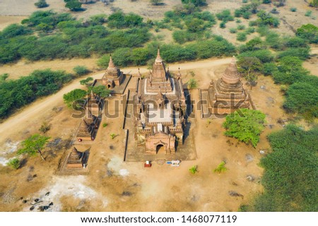 View from above, stunning aerial view of the beautiful Bagan Archaeological Zone (formerly Pagan) during sunset. Drone picture over hundreds of temples surrounded green rich vegetation, Myanmar. #1468077119