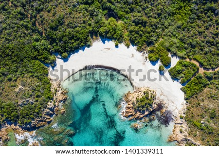 View from above, stunning aerial view of the Prince Beach (Spiaggia del Principe) bathed by a beautiful turquoise sea. Costa Smeralda (Emerald Coast) Sardinia, Italy.
