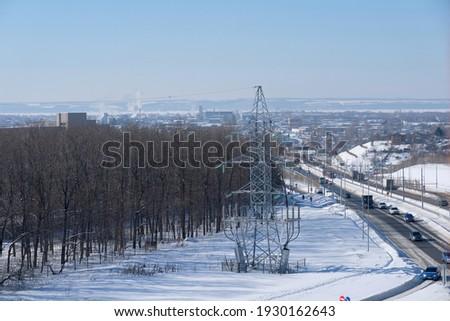 View from above to Baki Urmanche Street in Kazan. Winter sunny day image. City traffic