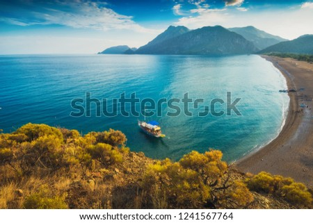 View from above to Cirali beach and Olimpos mountain in a sunset light. Kemer, Antalya, Mediterranean region, Turkey, Lycia. Stok fotoğraf ©