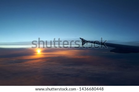 View from airplane. Colorful sunset/sunrise in the sky. #1436680448