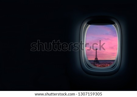 View from airplane window at sunset of the Paris. Eiffel tower in view, travel to paris concept for travel agency