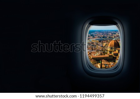 View from airplane window of the old city of florence.  #1194499357