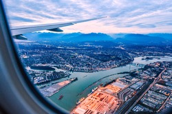 View from airplane window on fields in wing with top view of Vancouver,Canada