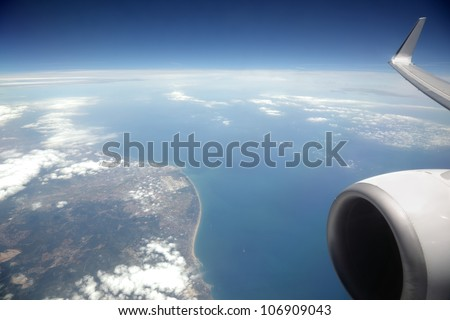 View from an aeroplane window of sea and coast