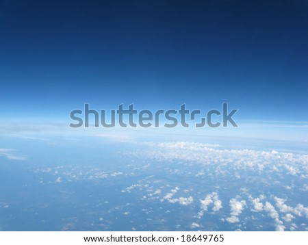 View from an airplane high above the clouds