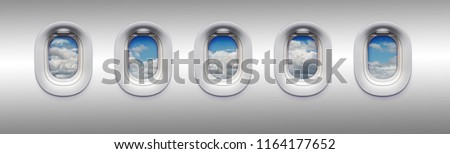 View from an airplane window with cloudy sky landscape outside. Row of portholes inside the passenger aircraft for your concept of airlines or air transportation.