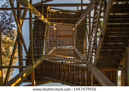 View from below into the inward of a wooden lookout tower. #1447479956