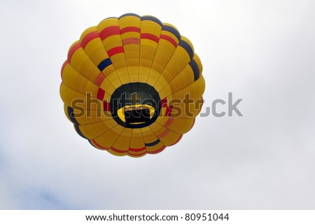 View from below of hot air balloon floating in the sky
