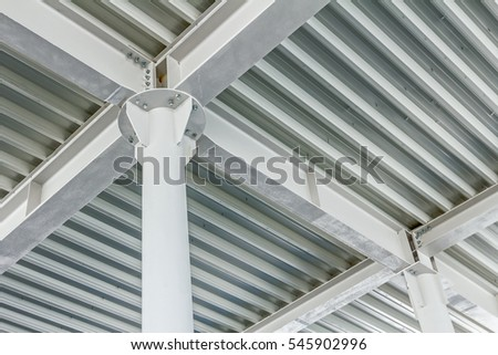 View from below on new ceiling; pillars with steel joints are painted in white. #545902996