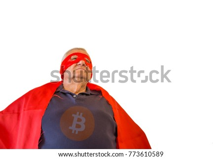 view from bottom of old man dressed as superhero sticking chest out and showing himself triumphant and powerful with public domain bitcoin logo