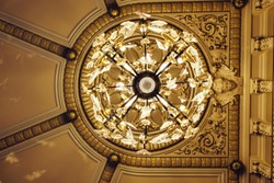 View from bottom to casino ceiling with rich chandelier. Monte Carlo, Monaco