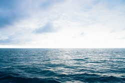 View from cabin balconies at the rough seas and waves off the side of cruise ship. Seascape picture. The sky with clouds, not big waves on the sea surface. Excitement at sea