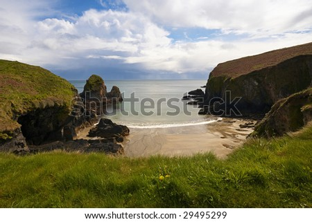 view from clifftops of sheltered strand at Nohovol Cove, Co.Cork, Republic Of Ireland - stock photo