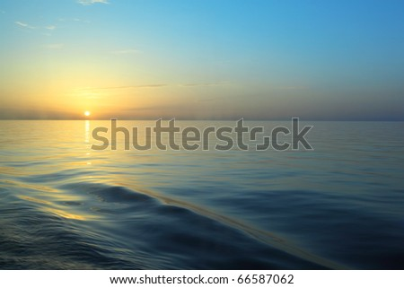 view from deck of cruise ship. beautiful sunrise under water.