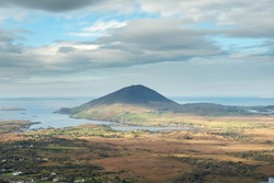 View from Diamond hill in Connemara National park, county Galway, Ireland, Bright sunny day, blue cloudy sky.