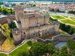 View from drone of imposing Castillo de Coca - medieval fortified castle in small Spanish town of Coca