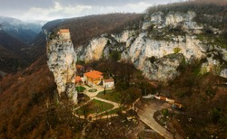 View from drone of Katskhi pillar, natural limestone monolith column with a monastery on the top in Georgia