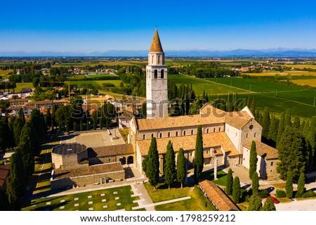 Photo of  View from drone of medieval Basilica di Santa Maria Assunta, principal church in small Italian town of Aquileia on sunny autumn day