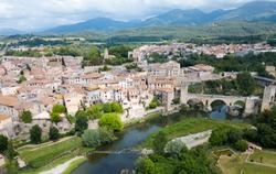 View from drone of medieval Spain town of Besalu with Romanesque bridge over Fluvia river