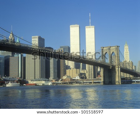 View from East River of the Brooklyn Bridge and skyline in New York City, New York