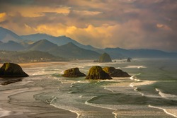 View from Ecola State Park looking south at sea stacks and haystack Rock at city of Canon Beach Oregon