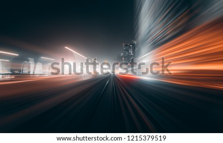View from first railway carriage. Speed motion blur metro abstract background at night #1215379519