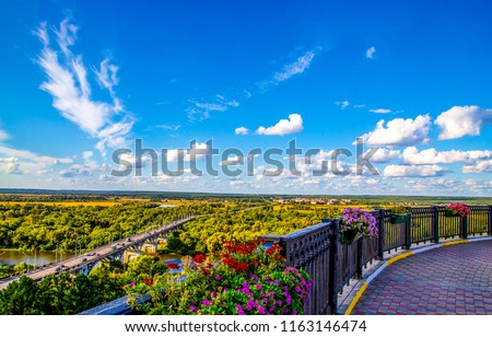 View from floral balcony at mountain valley town panorama. Balcony flowers panoramic view. View from balcony flowers panorama - Shutterstock ID 1163146474