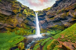View from flying drone of Kvernufoss watterfall. Amazing summer scene of pure water river in Iceland, Europe. Beauty of nature concept background.