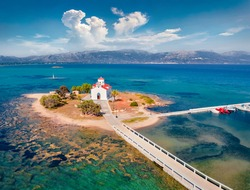 View from flying drone of Saint Spiridon church in Elafonisos port. Colorful morning seascape of Mediterranean Sea. Spectacular outdoor scene of Elafonisos island, Greece. Traveling concept background