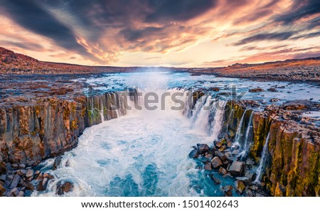 View from flying drone of Selfoss Waterfall. Awesome summer sunrise on Jokulsa a Fjollum river, Jokulsargljufur National Park. Colorful morning scene of Iceland, Europe.  #1501402643