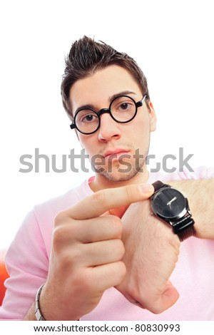 View from front of man in glasses looking at camera pointing at his watches wearing pink glamorous clothes