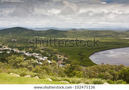 view from grassy hill overlooking the small town of Cooktown where James Cook landed - stock photo
