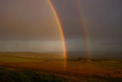 View From Hadrian's Wall of a Double Rainbow during a Storm, Northumberland, England, United Kingdom.