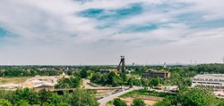 View from Halde Hoheward in Herten to old shaft tower in Recklinghausen, Germany