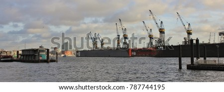 View from Hamburg Altona. Dock and harbour cranes at the Elbe.