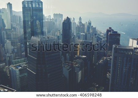 View from high on a business center with high skyscrapers and sea with floating yachts. Modern developed metropolitan city with office and commercial buildings with contemporary architecture  #406598248