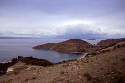 View from Isla del Sol, Titicaca Lake, Bolivia. Border of Peru and Bolivia. Dramatic cloudy sky.
