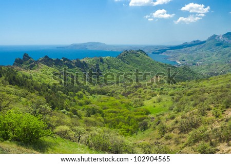 View from Karadag volcanic mountain range to Meganom cape in Eastern Crimea, on a Black Sea shore.