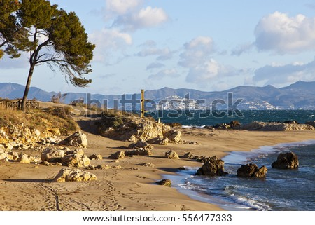 Shutterstock View from L'Escala across the bay of Rosas to the town of Rosas. The Tramontana wind has whipped up crowns on the waves on this January day.