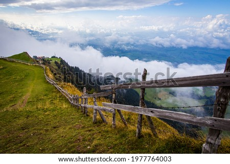 View from Mount Rigi summit (Rigi Kulm) with clouds and fog in Autumn. Beautiful view at the Alps on the top of Rigi moutain in Luzern, Switzerland Stock fotó ©