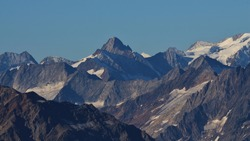 View from mount Titlis. Mountain peaks of the Swiss Alps in summer.