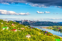 View from observation deck to residential districts of Ufa and Belaya river in summer evening at sunset. Beautiful cityscape, popular view of Ufa city, capital of Bashkiria