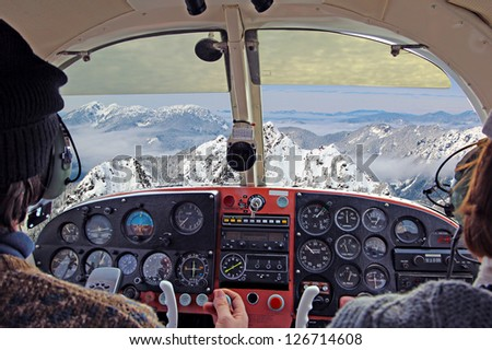 view from over snow covered peaks while flying in small plane Сток-фото ©