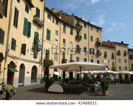 View from piazza Anfiteatro, former a Roman Ampitheatre, in Lucca. Tuscany, Italy.