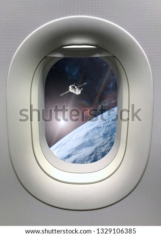View from porthole window on spacecraft launch into space. Elements of this image furnished by NASA.