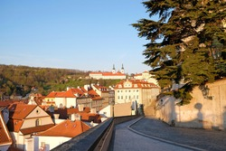 View from Prague Castle to Strahov Monastery  and houses at Mala Strana quarter with typical red rooftops. Prague the city with beautiful atmosphere. Early morning in Praha city with no tourists.