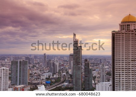 View from rooftop of skyscraper,twilight sky scene in the cityscape,Bangkok,Thailand